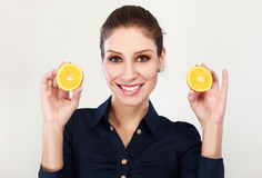 Woman with oranges. In her hands studio portrait  on white background Stock Photography