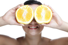 Woman with oranges in her hands Royalty Free Stock Photo