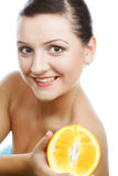 Woman with oranges in her hands Stock Image
