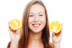 Woman with oranges in her hands Stock Photos