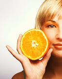Woman with oranges. Young blonde woman with oranges in her hands Royalty Free Stock Photo