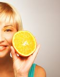 Woman with oranges. Young blonde woman with oranges in her hands Royalty Free Stock Photography