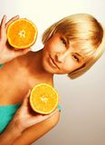 Woman with oranges. Young blonde woman with oranges in her hands Stock Image