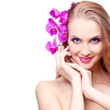 Woman with an orchid Royalty Free Stock Photo