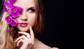 Woman with an orchid Stock Photo