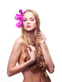 Woman with an orchid Royalty Free Stock Photos