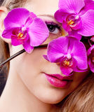 Woman with an orchid Stock Image