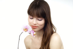Woman with an orchid Royalty Free Stock Photography