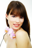 Woman with an orchid Royalty Free Stock Images