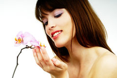 Woman with an orchid Stock Photos