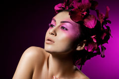 Woman with orchid Stock Image