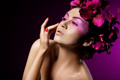 Woman with orchid Royalty Free Stock Photo