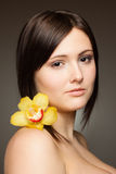 Woman with orchid Stock Photos