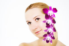 Woman with orchid Royalty Free Stock Image
