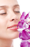 Woman and orchid Royalty Free Stock Photo