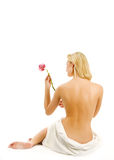 Woman with orchid flower Royalty Free Stock Image