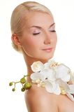 Woman with orchid flower Stock Photography