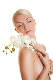 Woman with orchid flower Stock Photo