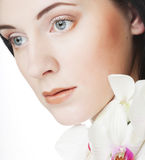 Woman with orchid flower Royalty Free Stock Photography