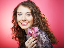 Woman with orchid flower over pink background Royalty Free Stock Photo