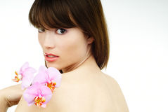 Woman with an orchid on her arm royalty free stock images
