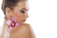 Woman and orchid royalty free stock image