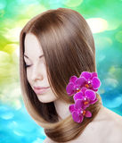 Woman with orchids in her gorgeous hair Royalty Free Stock Image