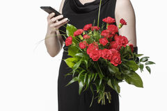 Woman ordering flowers via mobile phone Royalty Free Stock Image