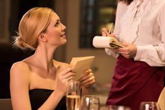 Woman ordering food Royalty Free Stock Image
