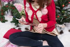 Woman ordering gift on internet. female buyer holding smartphone. For online shopping. girl use credit card for payment. christmas holiday. merry xmas Stock Photo