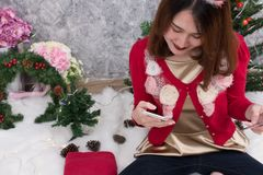 Woman ordering gift on internet. female buyer holding smartphone. For online shopping. girl use credit card for payment. christmas holiday. merry xmas Royalty Free Stock Images