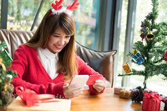 Woman ordering gift on internet. female buyer holding smartphone. For online shopping. girl use credit card for payment. christmas, new year holiday. merry xmas Royalty Free Stock Photography