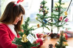 Woman ordering gift on internet. female buyer holding smartphone. For online shopping. girl use credit card for payment. christmas, new year holiday. merry xmas Royalty Free Stock Photo