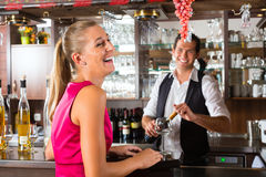 Woman ordering glass of wine at bar Royalty Free Stock Photography