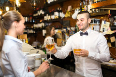 Woman ordering a glass of wine Royalty Free Stock Photos