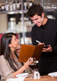 Woman ordering at a restaurant Royalty Free Stock Image