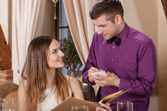 Woman ordering in a restaurant Stock Images