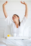Woman ordering room service Stock Image