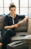 Woman ordering ticket online with tablet PC in loft apartment Stock Photo