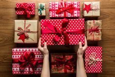 Woman organising beautifully wrapped vintage christmas presents, view from above Royalty Free Stock Image