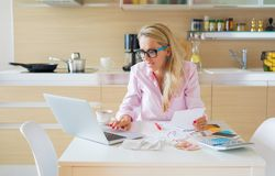Woman organizing personal accounting and finances Royalty Free Stock Photos