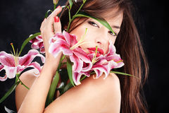 Woman with oriental flowers Royalty Free Stock Photo