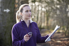 Woman Orienteering In Woodlands With Map And Compass Royalty Free Stock Photos