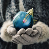 Woman with an ornamented christmas ball Royalty Free Stock Photos