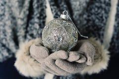 Woman with an ornamented christmas ball Stock Image