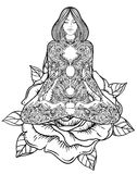 Woman ornate silhouette sitting in lotus pose. Meditation, aura Stock Photo