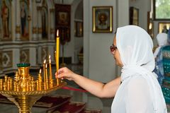 Woman in Orthodox Church royalty free stock photo