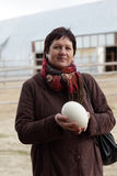 Woman with ostrich egg Royalty Free Stock Images