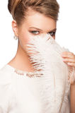 Woman with ostrich feather Royalty Free Stock Photos