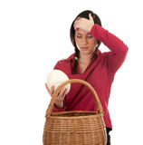 Woman with ostriches egg Stock Photo